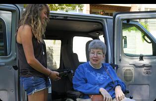 Caregiver helping patient in wheelchair